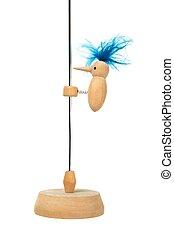 Wooden bird on a wire