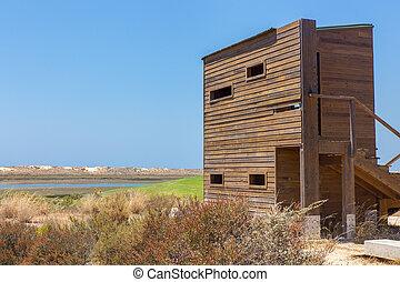 Wooden bird watching hut at portuguese coast