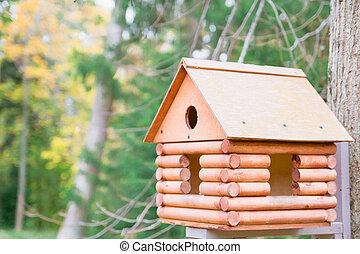 Wooden birdhouse in a beautiful autumn Park