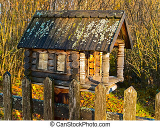 wooden birdhouse made in old house view