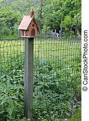 wooden birdhouse on a pole