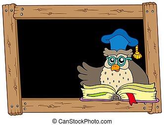 Wooden blackboard with owl teacher