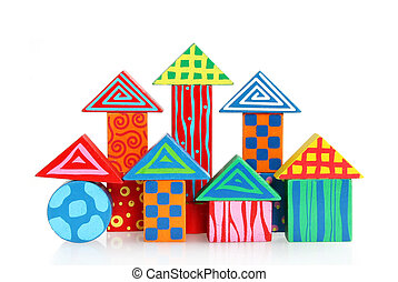 Wooden block houses against white background
