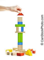 Wooden block tower under construction