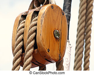 Wooden block - Up close of wooden block and ship rigging