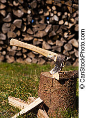 wooden block with ax and split wood - wooden block with a ax...