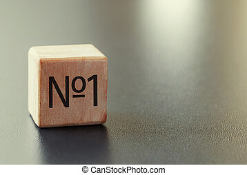 Wooden block with No 1 text