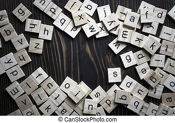 Wooden blocks alphabet on the wooden table.