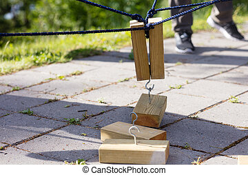 Wooden Blocks Being Lifted By Ropes