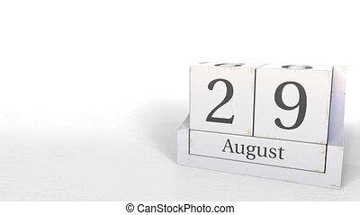 Wooden blocks calendar shows August 29 date, 3D animation -...