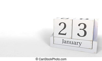 Wooden blocks calendar shows January 23 date, 3D animation...