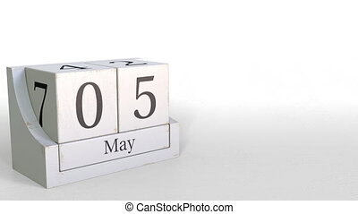 Wooden blocks calendar shows May 5 date, 3D animation - ...