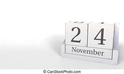 Wooden blocks calendar shows November 24 date, 3D animation...