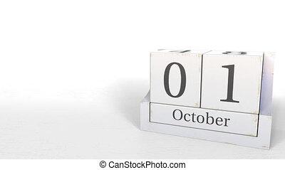 Wooden blocks calendar shows October 1 date, 3D animation -...