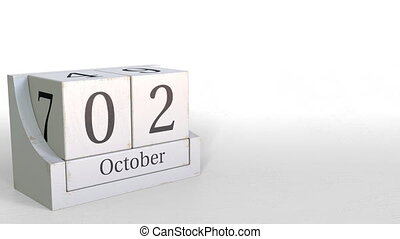 Wooden blocks calendar shows October 2 date, 3D animation -...