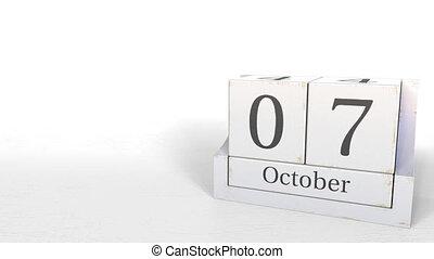 Wooden blocks calendar shows October 7 date, 3D animation -...