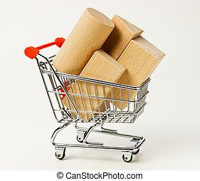 wooden blocks for the construction in shopping trolley on a white background