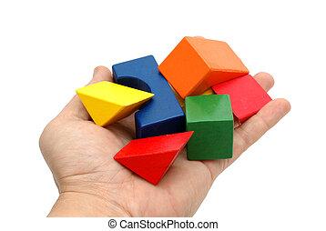Wooden blocks in hand