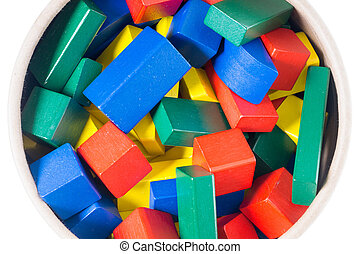 Wooden blocks - many colorful wooden blocks in a bucket