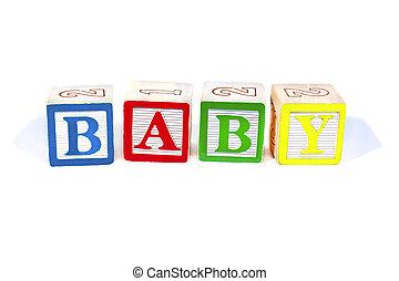 Wooden blocks spell baby