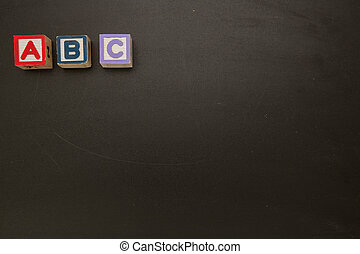 Wooden blocks spelling out abc