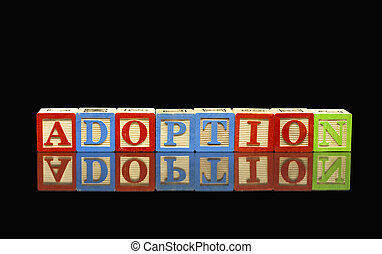 adoption - wooden blocks spelling out adoption on black with...
