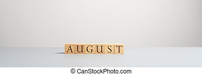 Wooden blocks spelling the word August