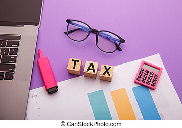 Wooden blocks with TAX word