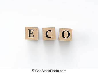 Wooden blocks with the word ECO written on them on a white background.