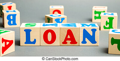 Wooden blocks with the word Loan. Consumer, banking and property loan. Business and entrepreneurial development. Small business loans. Interest rate repayment. Planning. Mortgage. Credit