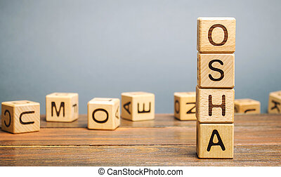 Wooden blocks with the word OSHA - Occupational Safety and Health Administration.