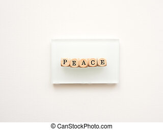 Wooden blocks with the word peace on a white background