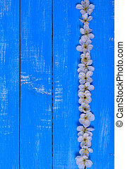 Wooden blue background with flowers