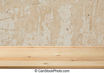 Wooden board empty table in front of a blurred background. Perspective brown wood with blurry grunge or old wall backdrop - can be used to showcase or mount your products. Mock up to display the product.