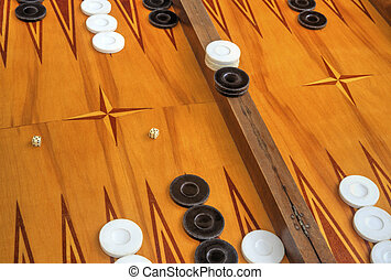 Wooden board for playing backgammon game with pools and dice