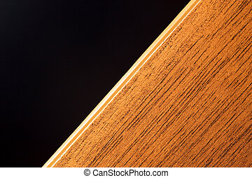 wooden board on a black background