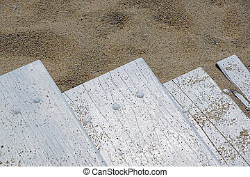 wooden board on the beach
