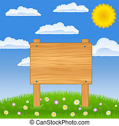 Wooden board on the green field