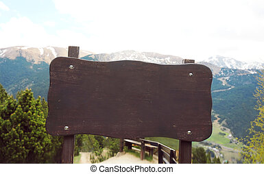 Wooden board signboard or sign on a mountain background