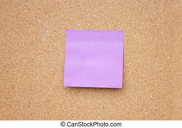 Wooden board with blank sticky note.
