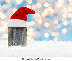 Wooden board with Christmas hat