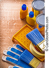 Wooden board with group of house improvement paint tools ...