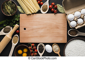 Wooden board with herbs and salt on dark wooden background top view