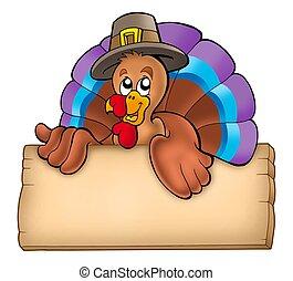 Wooden board with lurking turkey