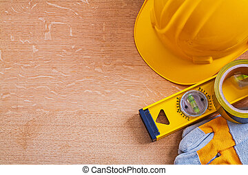 Wooden board with set of construction tools maintenance concept