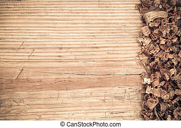 old wooden board with woodchips background