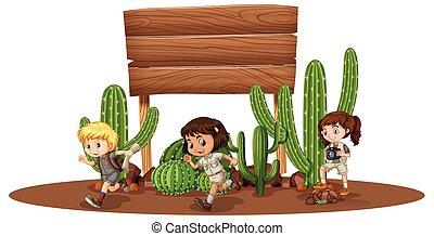 Wooden board with three kids in desert