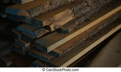wooden boards lie on the floor, timber or lumber is in the...