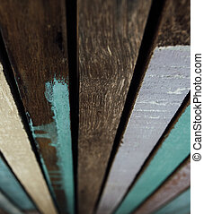 Wooden boards painted with colorful paint. Background old colored wooden paints