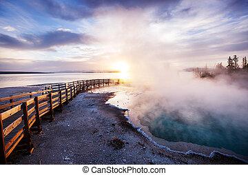 Yellowstone - Wooden boardwalk along geyser fields in...